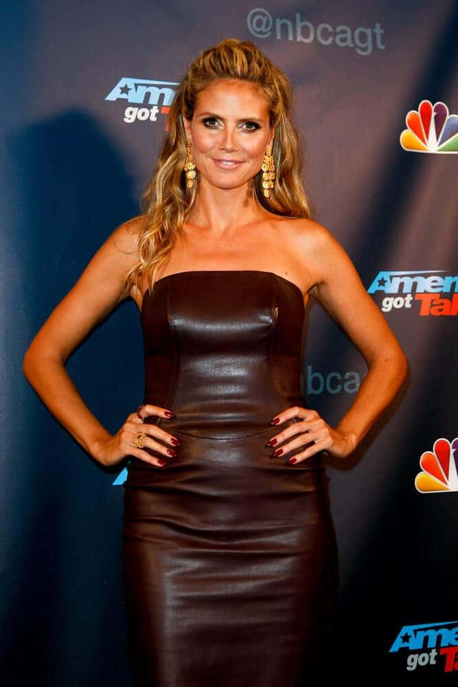 The iconic model/actress showcased her sexy and fierce figure with her skinny leather dress and wavy half-up hairstyle during the post-show red carpet for NBC's America's Got Talent Season 8, August 28, 2013.