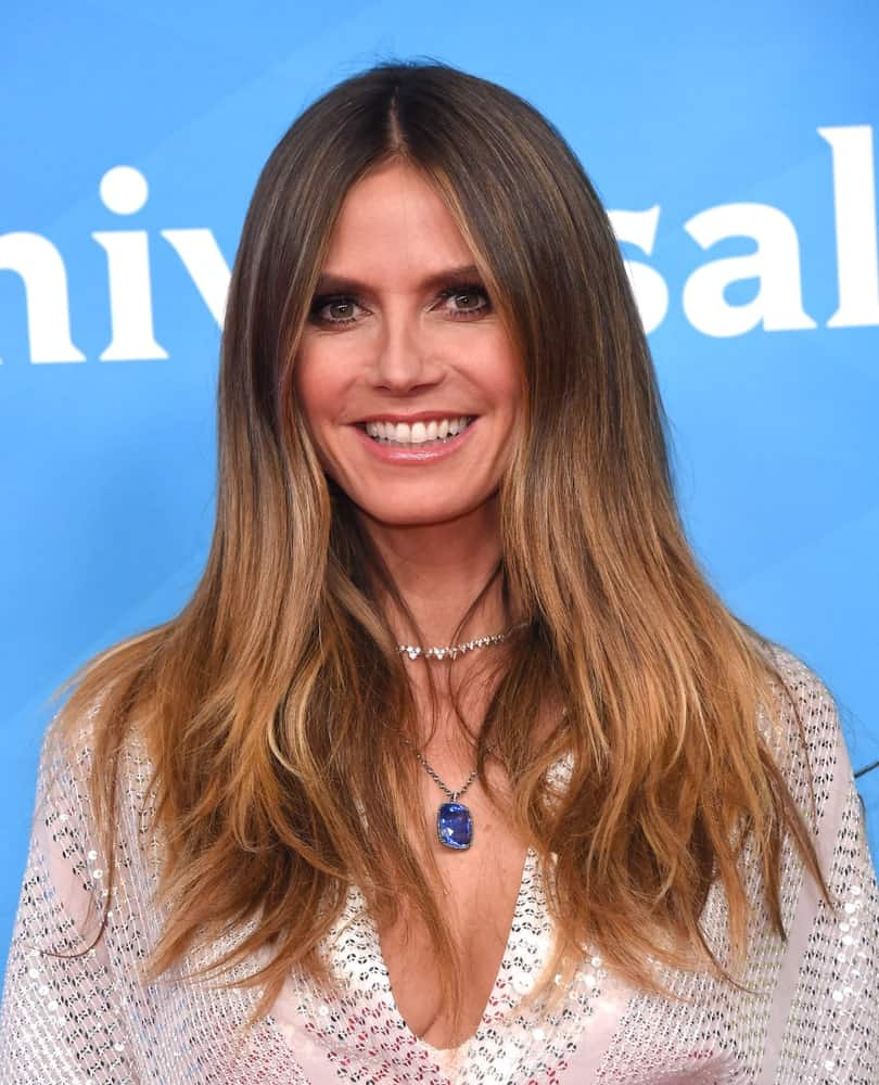 During the NBCUniversal Summer Press Day 2018, the German model shows off a charming look showcasing a volumized center-parted hair accented with a stunning necklace.
