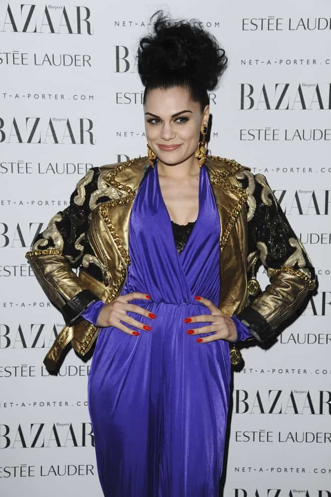 Jessie J went for a beehive hairstyle with her large hair bun at the top of her head. This is paired with a blue romper and gold leather jacket for the Harpers Bazaar Women of the Year Awards 2011 in London last November 7, 2011.