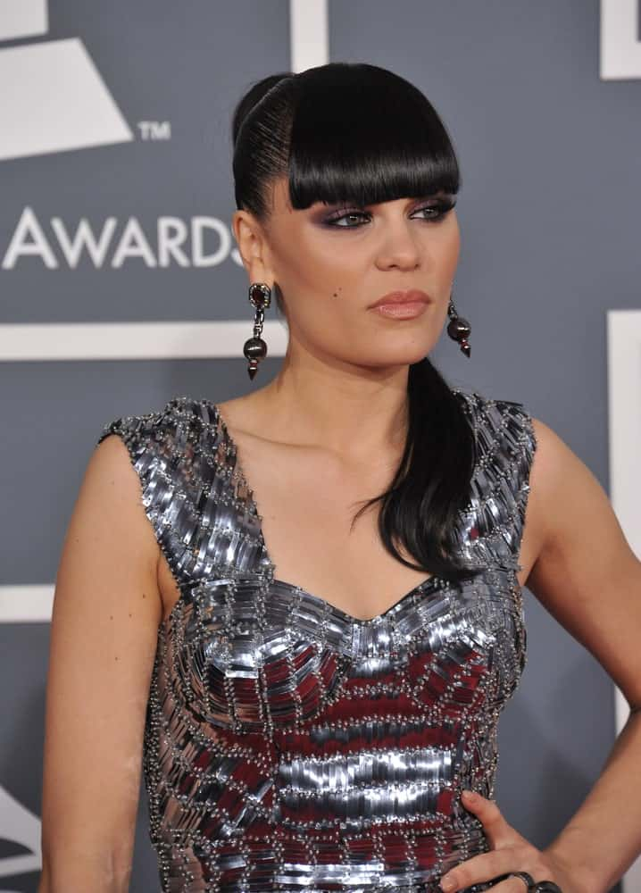 Jessie J wore a sophisticated and slick high ponytail with eye-skimmer bangs at the Grammy Awards 2012 last February 12, 2012 in Los Angeles.
