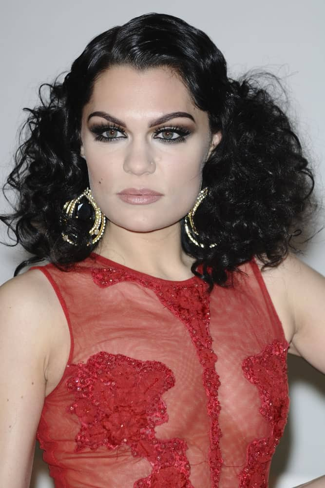 Jessie J's stunning sheer red outfit is paired with this vintage curly hairstyle that exudes sophistication last February 21, 2012 for the Brit Awards 2012 at the O2 arena in London.