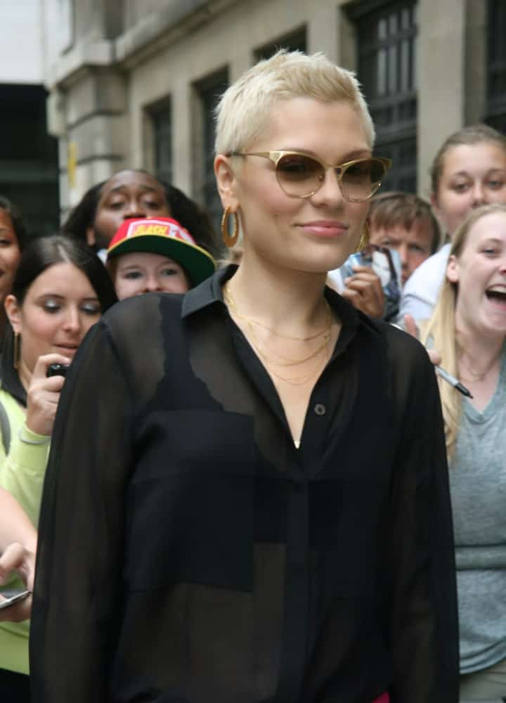 Jessie J was seen at the BBC radio two studio last August 5, 2013 in London with a black sheer button shirt contrasted by her bright blond spiked pixie hairstyle.