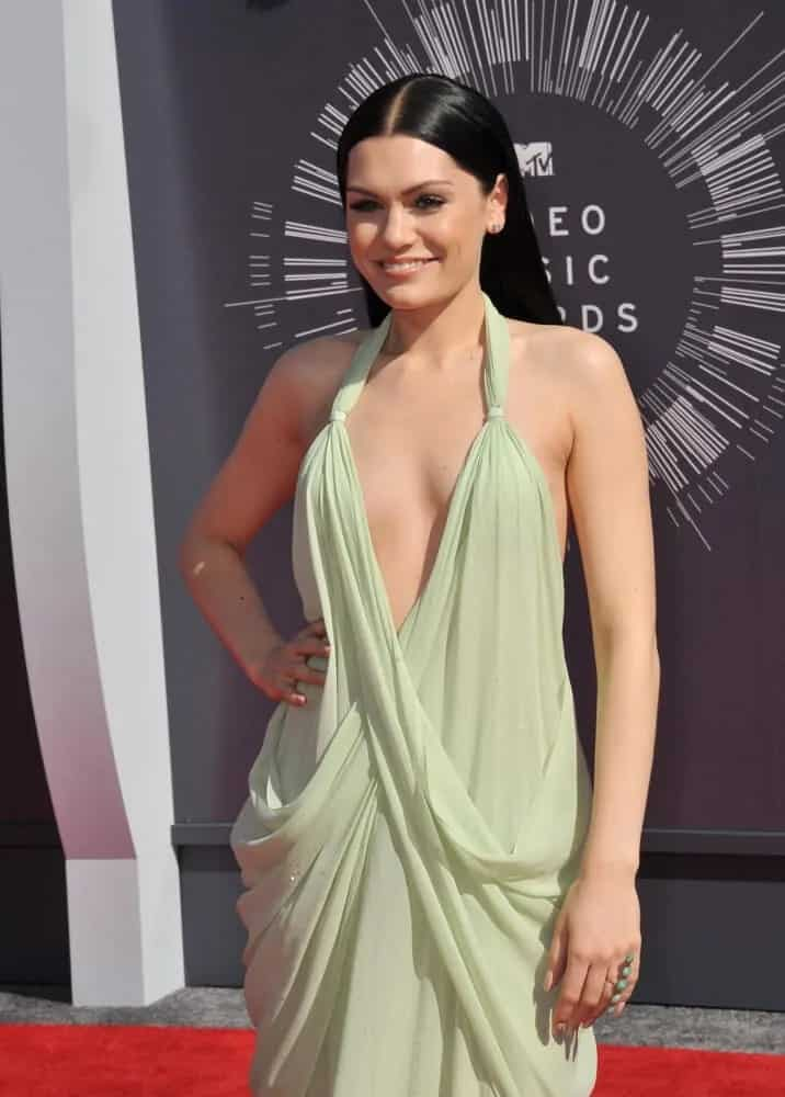 The singer channeled her inner goddess when she attended the 2014 MTV Video Music Awards in a sexy, light olive dress complemented by her long slick raven hair that is straight as silk.