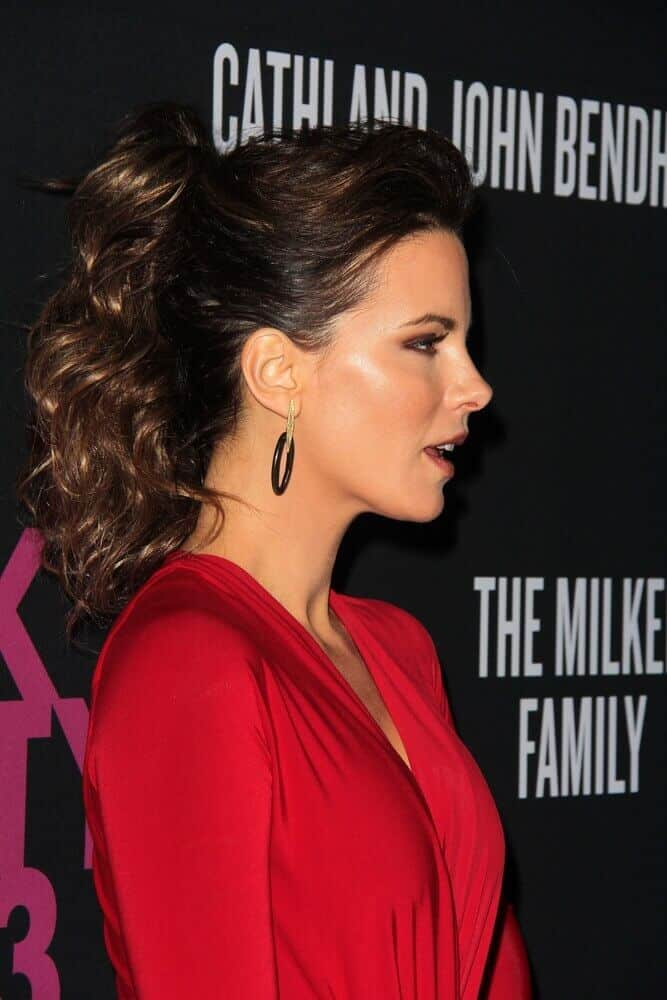 A little volume will do no harm like how this semi-teased curly ponytail was worn by the actress for the Pink Party 2013 held at Santa Monica, CA.