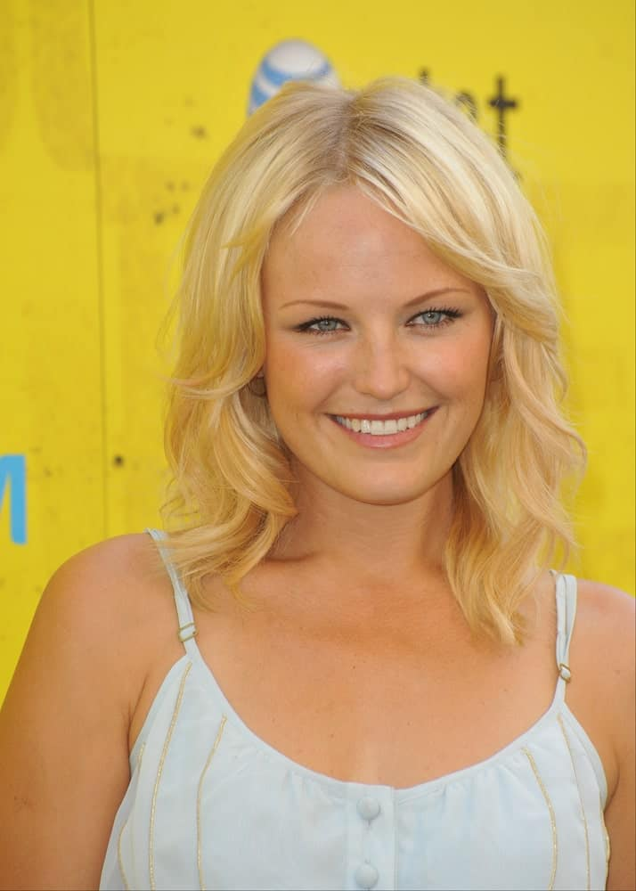 Malin Akerman attended the September 8, 2009 Get Schooled Conference and premiere of TV documentary at Paramount Studios. She had a relaxed and loose tousled wavy blond hair that has curls and layers.