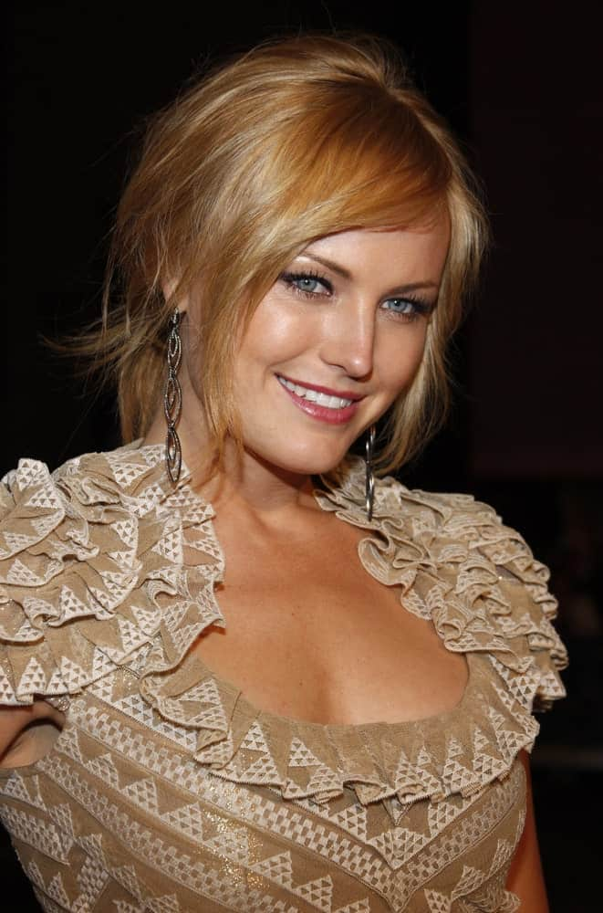 Malin Akerman was at the Los Angeles premiere of 'Watchmen' in Hollywood last March 3, 2009. Her brown detailed dress was a nice match for her messy updo that has reddish brown highlights.