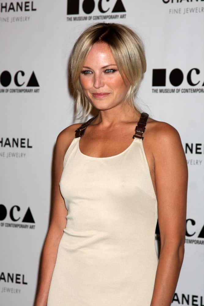 Malin Akerman's hair was styled into this half up pinned hairstyle that makes it look like a pixie cut. This was taken last November 13, 2010 at the MOCA's Annual Gala