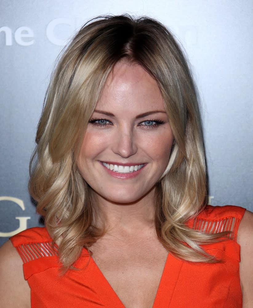 Malin Akerman's bright smile was as bright as her layered shoulder-length blond hair that is given a slight tousle by the end at the Bvlgari Hosts Funraiser for Save The Children last January 13, 2011 in Los Angeles.
