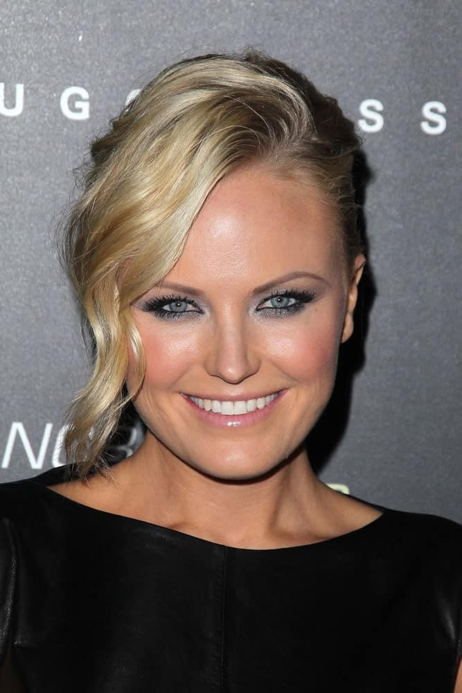 Malin Akerman showcased her blond hair with a half-up hairstyle and wavy side-swept bangs at the