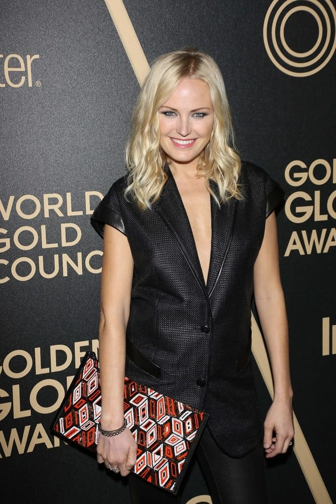 Malin Akerman was quite stylish and lovely in her black-on-black ensemble that makes her bright blond loose waves stand out at the Hollywood Foreign Press Association And InStyle Miss Golden Globe 2013 Party.