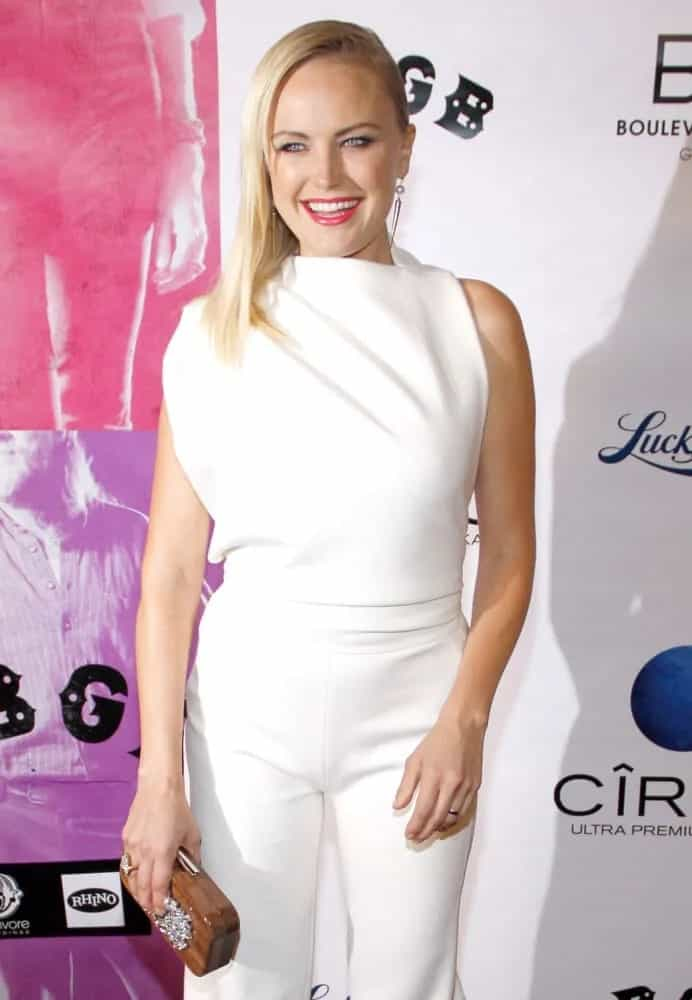 The actress an appearance with a high-fashion white romper and a side-swept, straight hairstyle to emphasize her earrings. The event was held last October 1, 2013 at the ArcLight Cinemas in Hollywood, California, United States.
