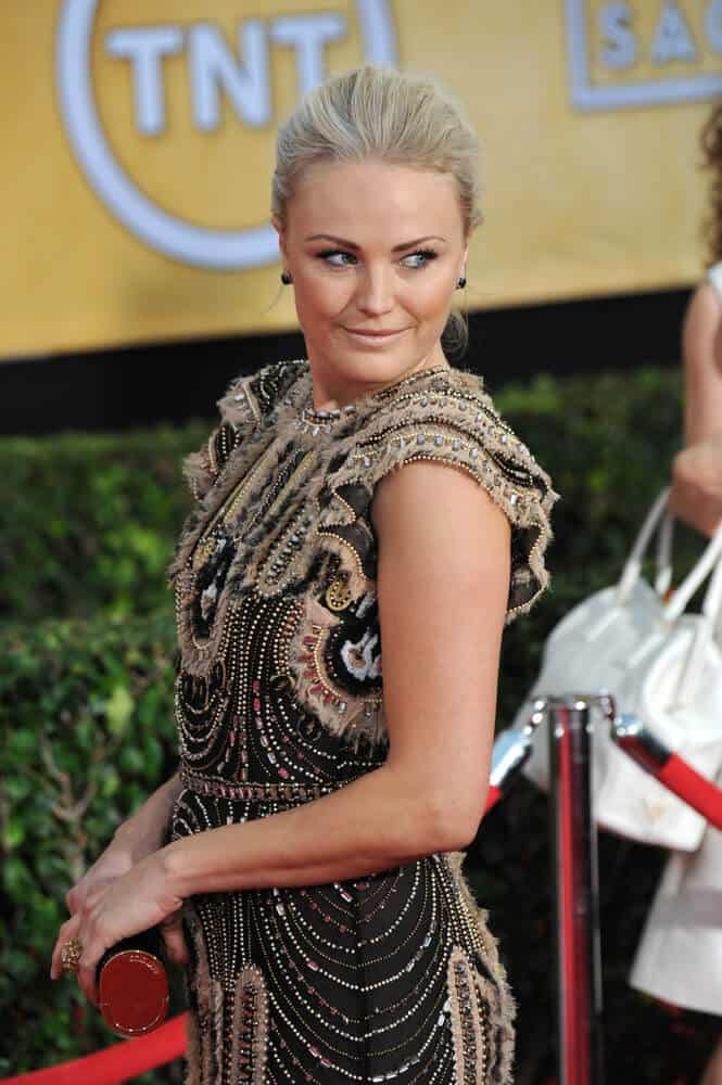 The actress' light blonde hair is arranged in a sophisticated pinned-up style at the 20th Annual Screen Actors Guild Awards, January 18, 2014.