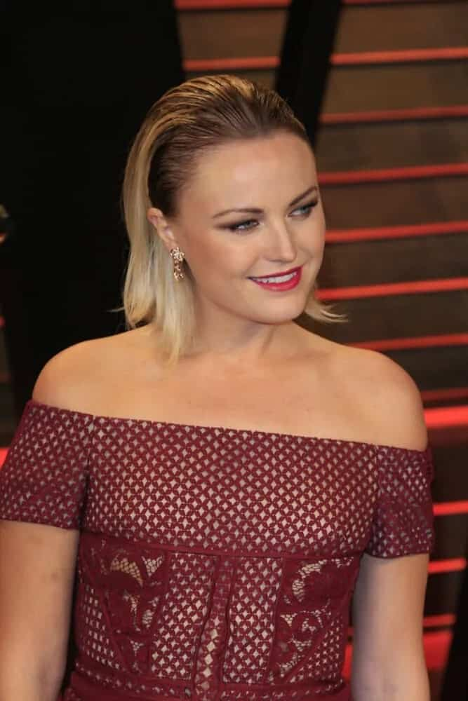 Malin Akerman totally pulled-off this medium-length slicked back hairstyle during the 2014 Vanity Fair Oscar Party wearing a maroon detailed dress and red lips.