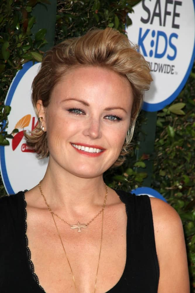 Malin Akerman was at the Safe Kids Day LA last April 26, 2015 in Los Angeles wearing a bright smile paired with her short bob styled to a half-up semi-pompadour look.