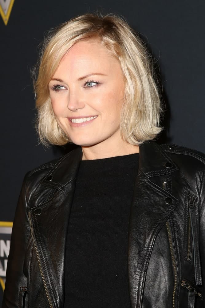 The talented actress was at the Monster Jam Celebrity Night last January 16, 2016 in Anaheim with a rocker chic ensemble and a casual tousled side-swept blond bob hairstyle.