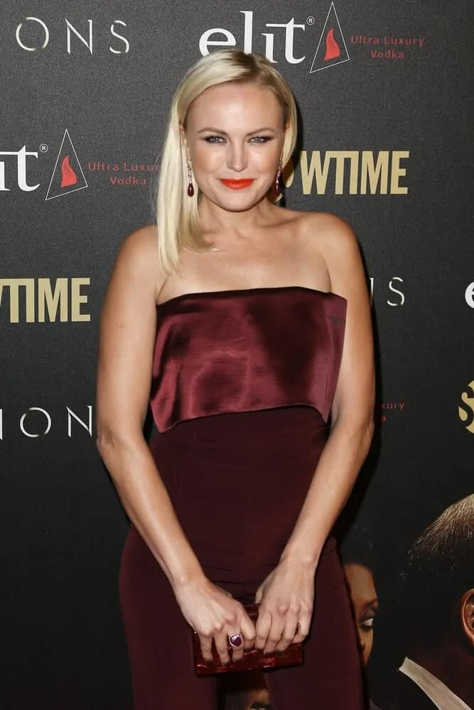 The actress attended the Billions Season 2 Premiere at Cipriani's last February 13, 2017 wearing a dark red romper paired with a sleek and straight half-up hairstyle.