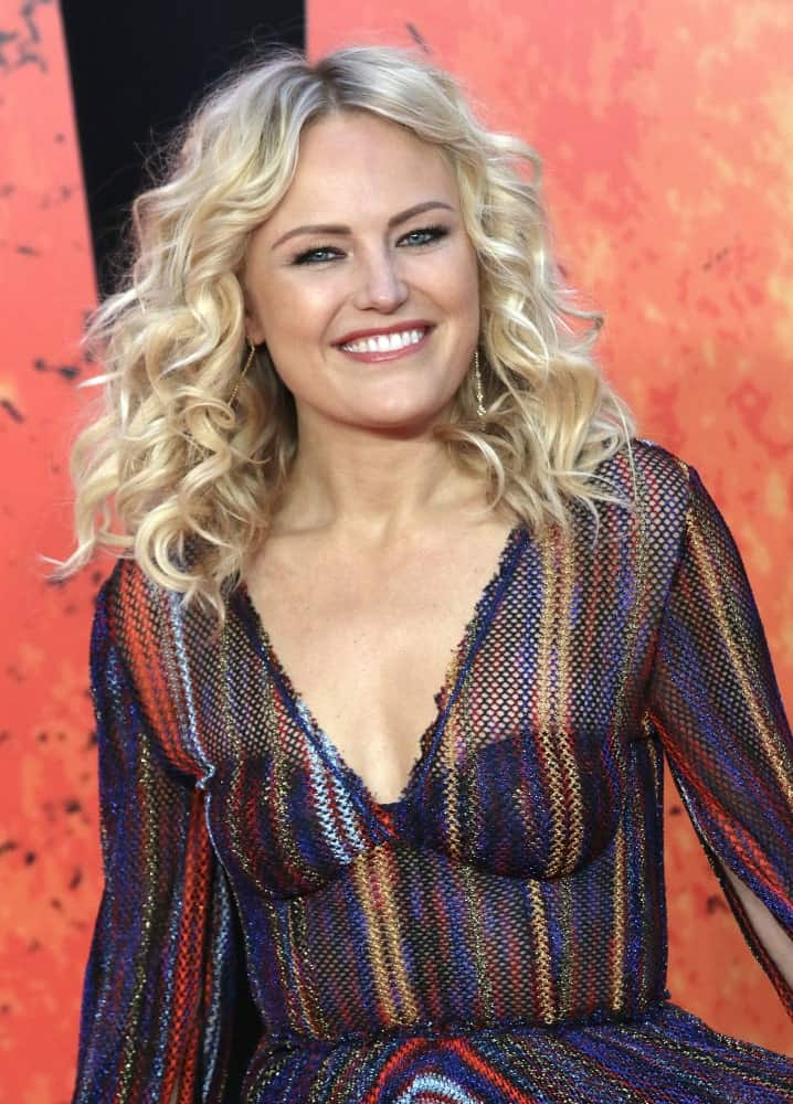 Malin Akerman's colorful sheer dress was complemented by her tousled curly blond hair when she attended the Rampage film premiere last April 11, 2018 at the Cineworld, Leicester Square.