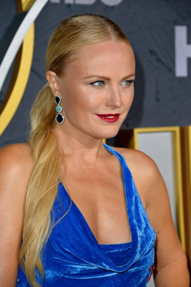 Malin Akerman attended the HBO post-Emmy Party at the Pacific Design Centre last September 23, 2019 wearing bold lips with her blue velvet dress and slick blond ponytail.