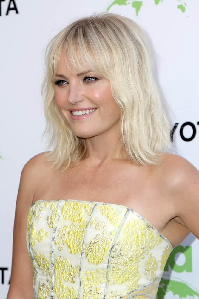 Malin Akerman's bright blond hair with beach waves matches well with her sunny dress at the 29th Annual Environmental Media Awards at the Montage Hotel last May 30, 2019.