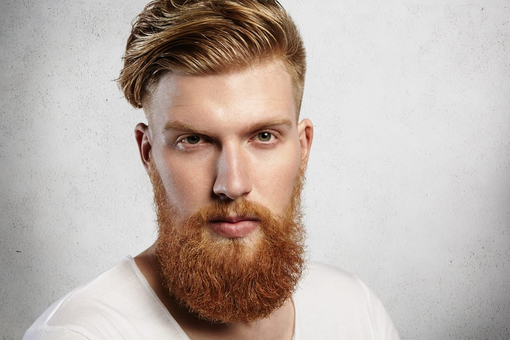 Man with undercut with thick hair and hipster beard