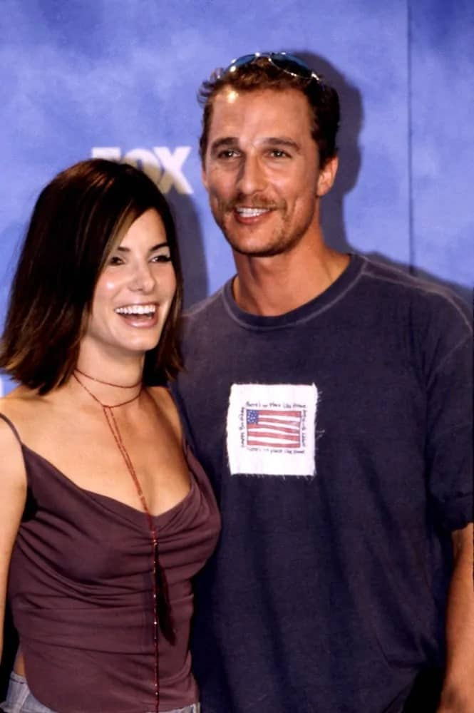 Matthew McConaughey looked casual with his shirt and a short dark crew cut hairstyle when he posed with Sandra Bullocks at the 1999 Teen Choice Awards.