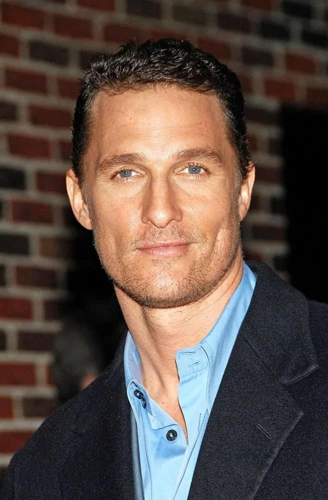 Matthew McConaughey sported a short cropped hair during a talk show appearance at the Late Show with David Letterman paired with his five o'clock shadow and dark suit.