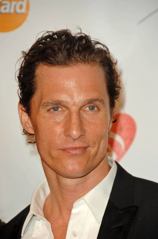 Matthew McConaughey had short dark curls with dark brown highlights when he attended the 2010 MusiCares Person Of The Year Tribute To Neil Young, Los Angeles Convention Center.