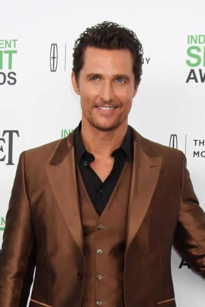 The actor gave off a confident vibe with his five o'clock shadow, shiny tan suit and fresh crew cut curly hairstyle when he attended the Film Independent Spirit Awards.