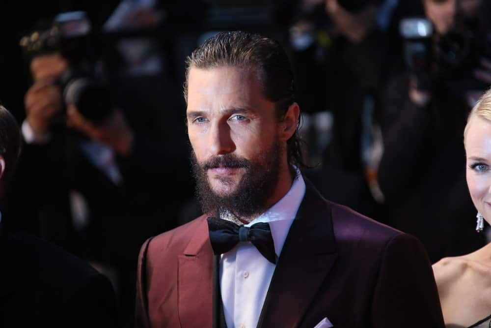 Matthew McConaughey's dark red suit complements his sophisticated slicked-back long wavy hair and thick beard at the premiere of 'The Sea Of Trees' during the 68th annual Cannes Film Festival last May 16, 2015 in Cannes, France.