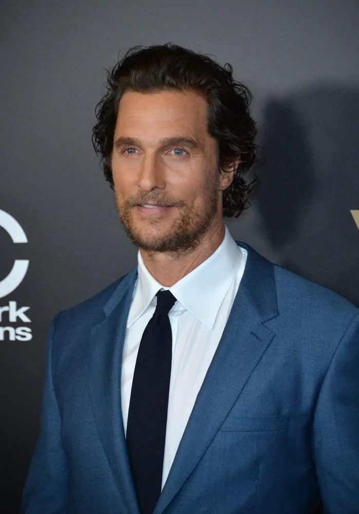 Talented actor Matthew McConaughey was at the 2016 Hollywood Film Awards at the Beverly Hilton Hotel wearing a dapper blue suit with his wavy long hair pushed back with a slight pompadour style.