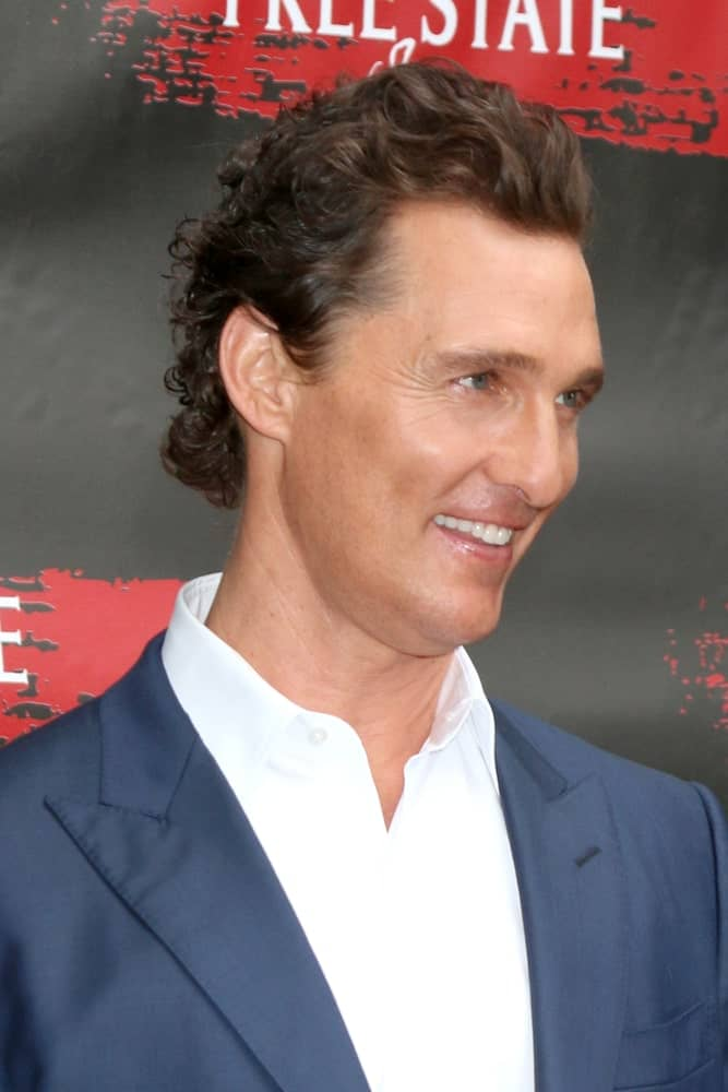 Matthew McConaughey had dark brown highlights to his brushed-back wavy curls at the Free State Of Jones Photocall at the Four Seasons Hotel Los Angeles last May 11, 2016 in Los Angeles. This is paired well with his neat clean shave and bright smile.