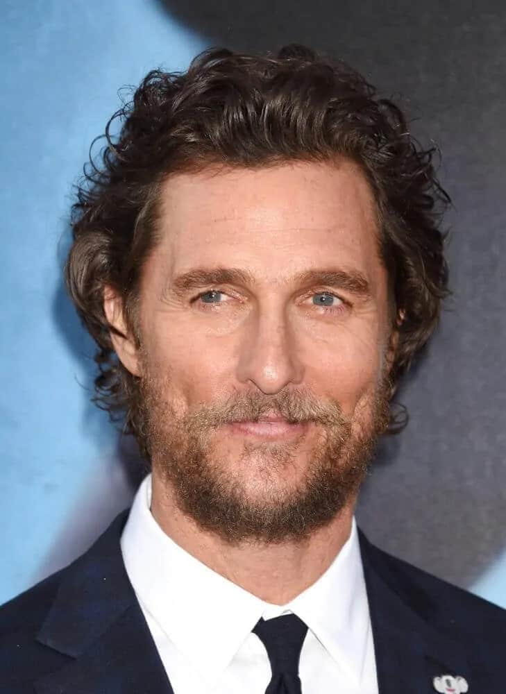 Matthew McConaughey's iconic beach curls were tousled for a bit of volume that went well with his scruffy beard during the World Premiere of