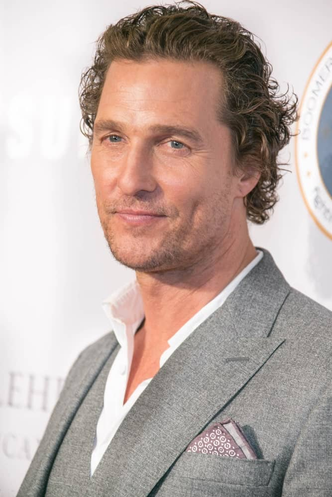 Last September 27, 2018, Matthew McConaughey attended the 17th Annual Samsung Charity Gala wearing a dapper gray suit to match his messy brushed-back dark brown beach waves capped off with five o'clock shadow.
