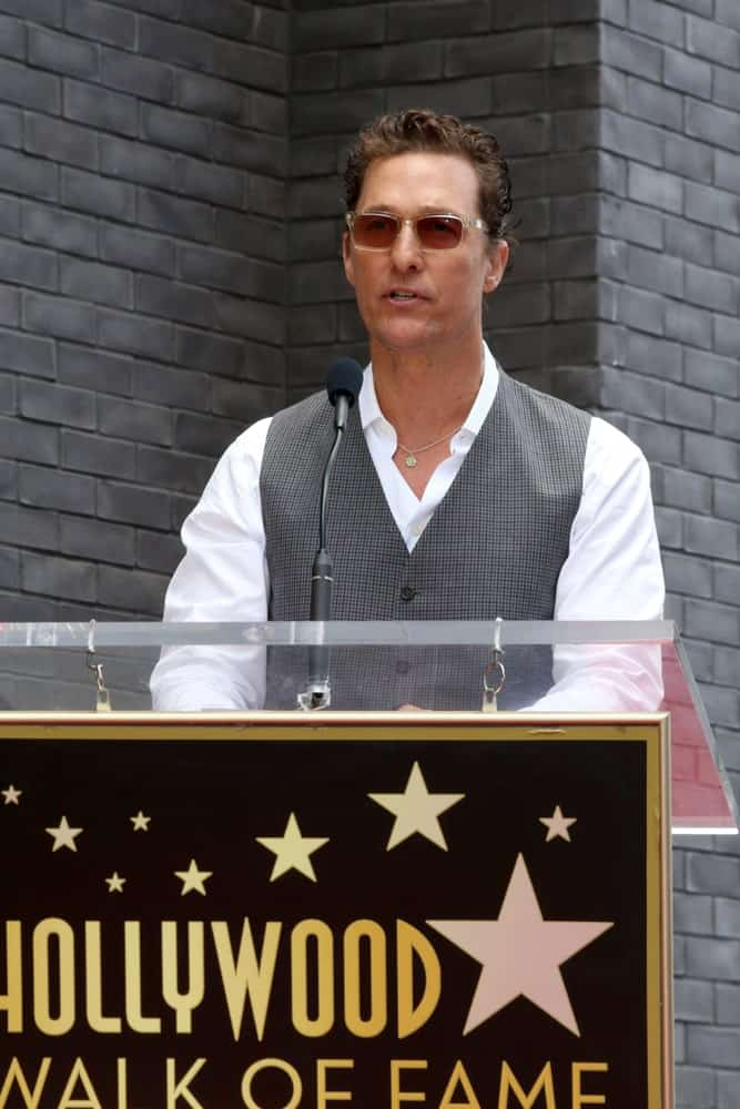 Matthew McConaughey was at the Guy Fieri Star Ceremony on the Hollywood Walk of Fame last May 22, 2019 in Los Angeles with a neat brushed back tame to his dark curls that goes well with his clean-shaved look.