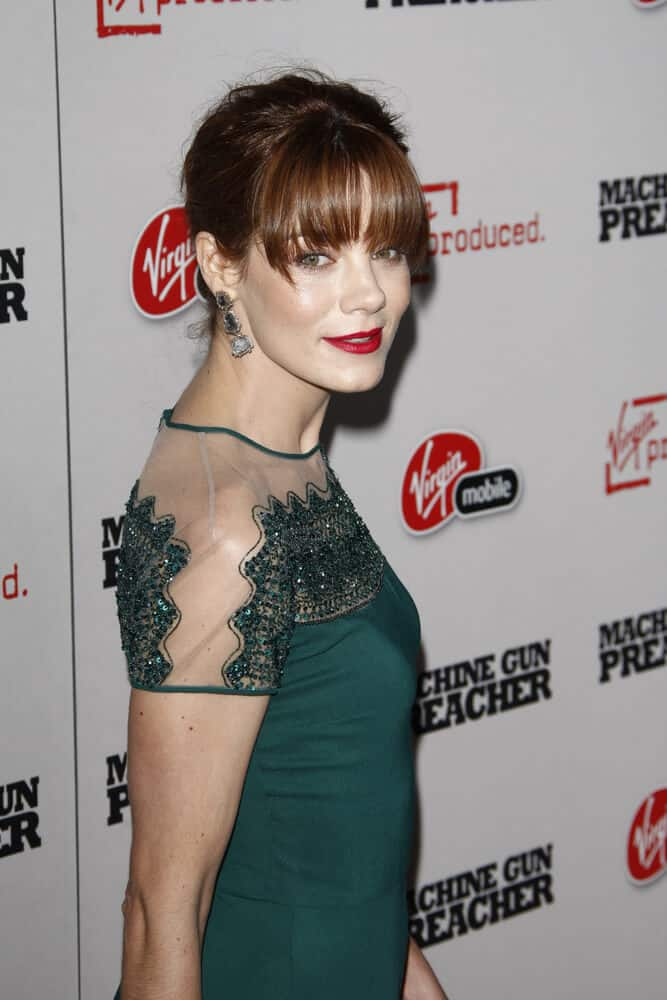 "The actress exhibited a different side of her during the premiere of ""Machine Gun Preacher"" last September 21, 2011. She had her hair arranged into a nice updo incorporated with straight bangs."