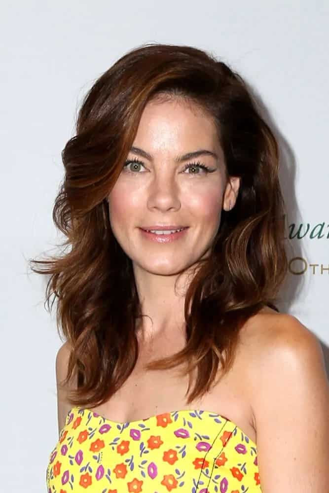 Michelle Monaghan wore a cheerful sunny dress with the sexy side-swept curls at the 40th Anniversary of the Rolex Awards for Enterprise last November 15, 2016.
