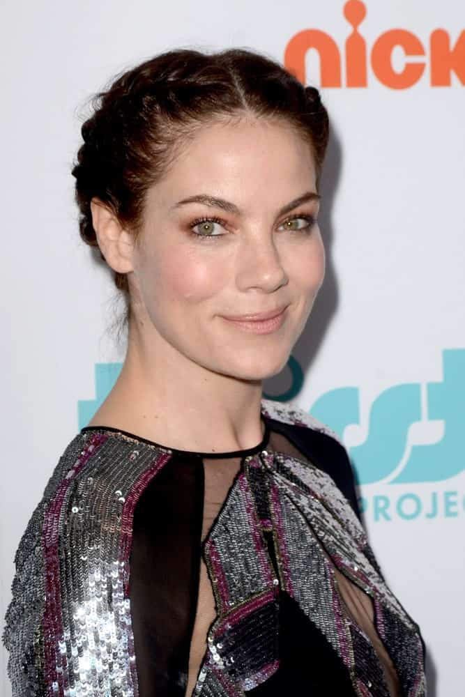Michelle Monaghan was at the 9th Annual Thirst Gala on the Beverly Hilton Hotel on April 21, 2018 in Beverly Hills, CA. She was wearing a shiny silver sequined dress complemented by her updo braided hair to highlight her neckline.
