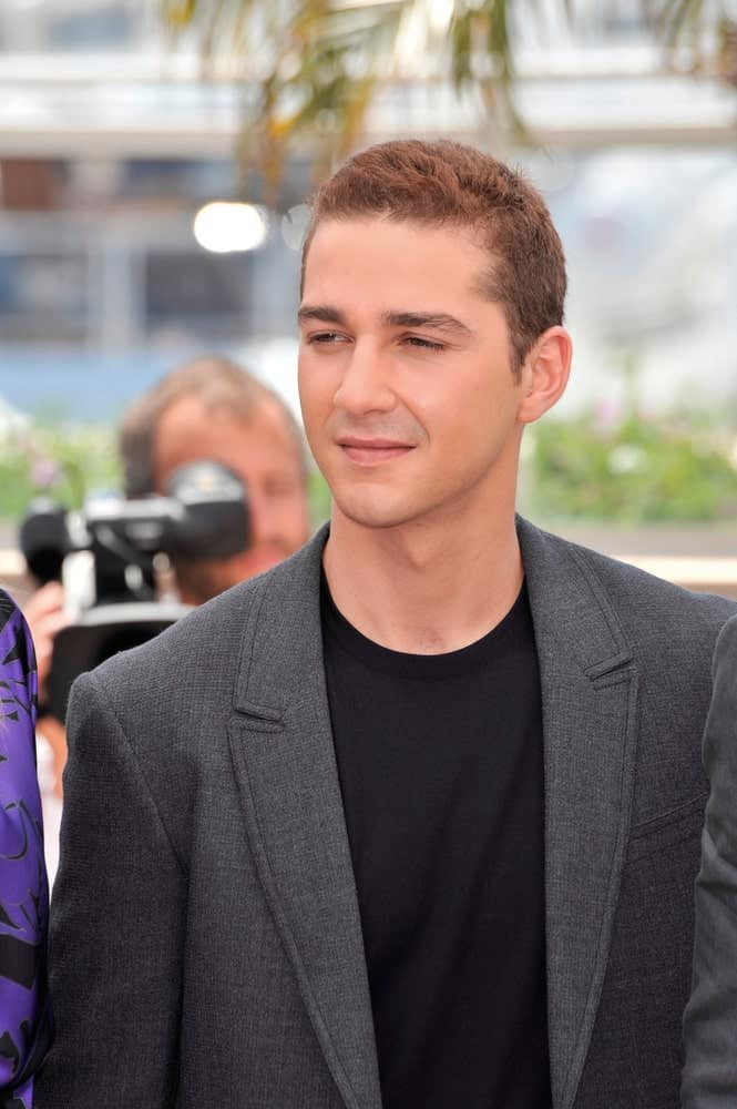 "Shia LaBeouf was at the photocall for his movie ""Indiana Jones and the Kingdom of the Crystal Skull"" at the 61st Annual Cannes Film Festival last May 18, 2008. He was wearing a simple charcoal suit and black shirt to match his highlighted short hair."