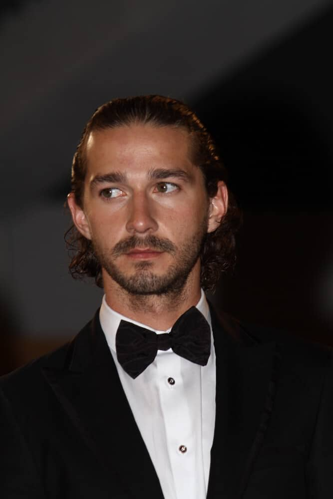 The actor's curly hair is styled into this neat slicked back look last May 19, 2012 for the  65th Annual Cannes Film Festival.