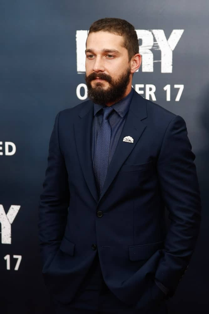 The actor's curls were reigned in with a short classic hairstyle complemented with a thick beard when he attended the world premiere of