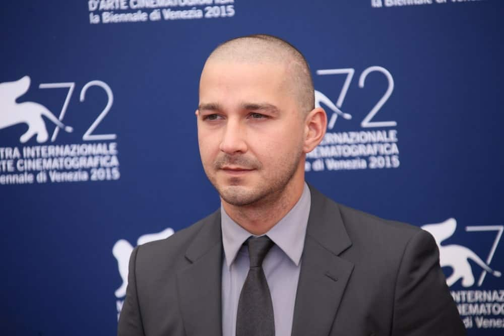 Shia LaBeouf attended the photocall for 'Man Down' during the 72nd Venice Film Festival at on September 6, 2015 in Venice, Italy with a skinhead hairstyle and five o'clock shadow to match his charcoal suit.