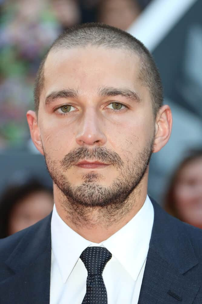 Labeouf in a short, military cut has a powerful impact. His facial features  leaves a significant statement to his overall getup. This photo was taken 'Man Down' premiere last September 15, 2015 during the 2015 Toronto International Film Festival .