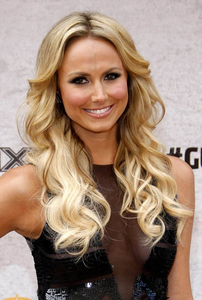 Stacy Keibler flaunts her captivating black dress along with her highlighted blonde hair in defined curls. This was worn during the 2011 Spike TV's Guys Choice Awards held on June 4, 2011.