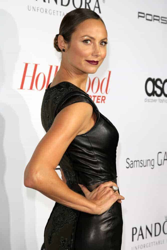 The model's dark make-up look is well-balanced with her simple braided updo she wore during The Hollywood Reporter's Emmy Party, September 19, 2013.