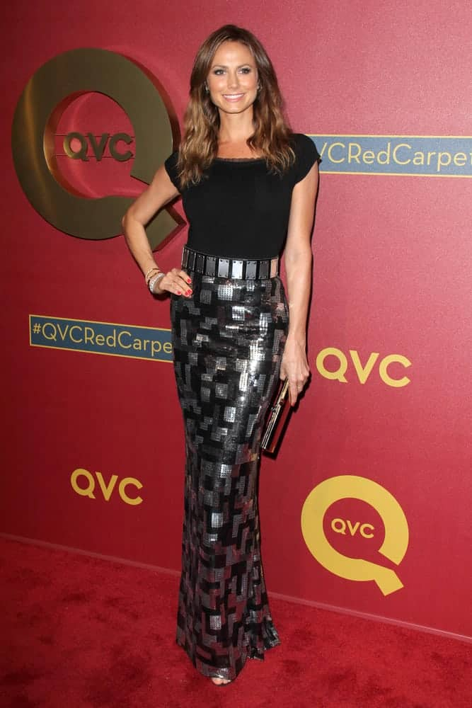 The actress went a little shade darker than her usual hair color during the QVC 5th Annual Red Carpet Style Event. She looks stunning with her loose waves black and silver evening gown.