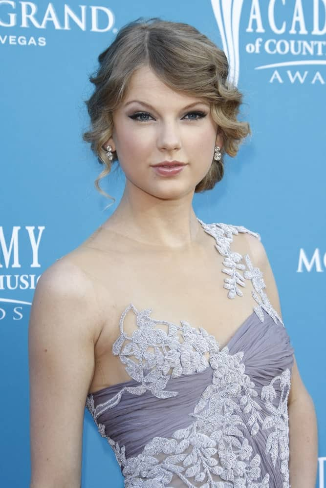Taylor Swift gathered her long curly tresses into a classic low side bun during the 45th Annual Academy of Country Music Awards held at the MGM Grand Garden Arena on April 18, 2010.