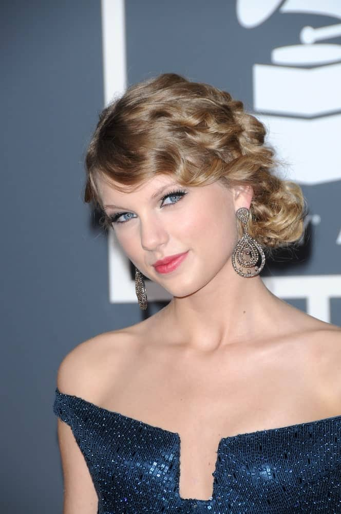 Taylor Swift wore a stunning blue dress paired with a curly side bun during the 52nd Annual Grammy Awards - Arrivals at Staples Center, Los Angeles, CA on January 31, 2010.