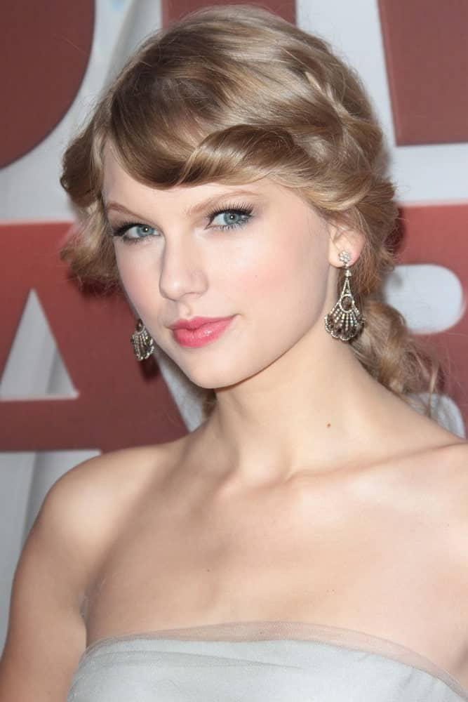 Taylor Swift went with a classy upstyle and twisted bangs at the 2011 CMA Awards held at Bridgestone Arena, Nashville, TN on November 9, 2011.