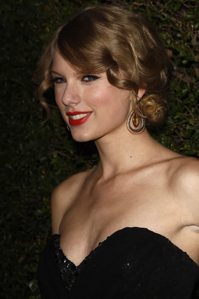 The singer maintained her curly glam updo for the COVERGIRL 50th Anniversary Celebration at BOA Steakhouse held on January 5, 2011.