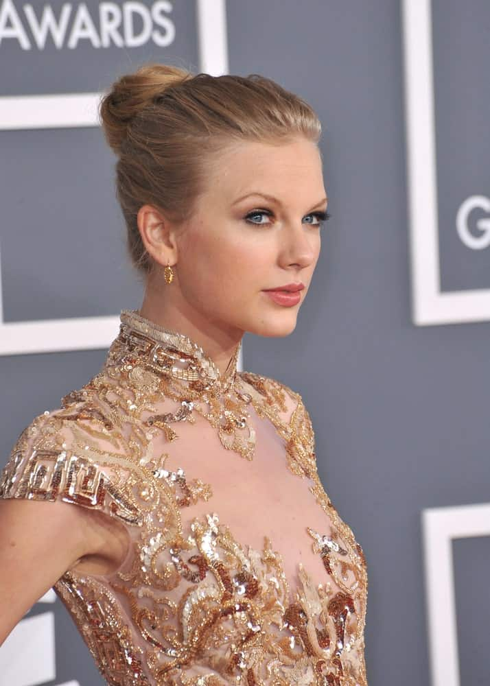 Taylor Swift slicked back her hair into a neat bun during the 54th Annual Grammy Awards at the Staples Centre, Los Angeles held on February 12, 2012.